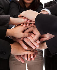 Businesspeople collaborating and coming together as a team