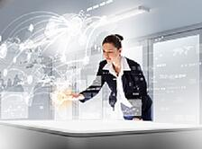 Businesswoman_with_high_tech_background_white_smaller