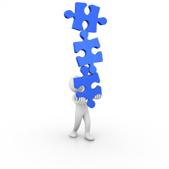White_man_carrying_blue_jigsaw_puzzle_pieces_in_stack