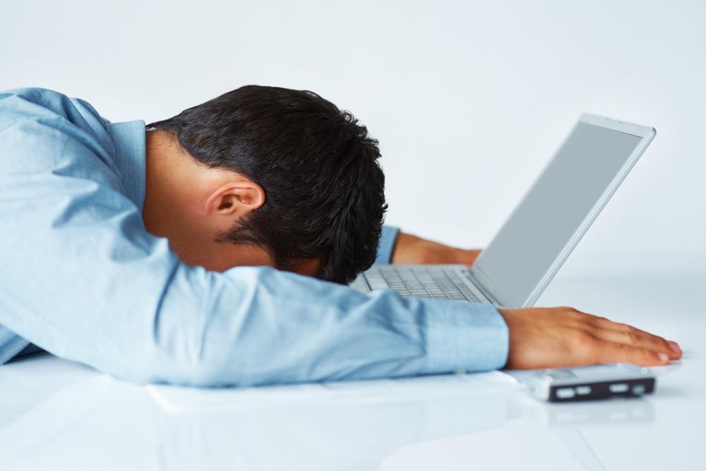 man_asleep_on_laptop