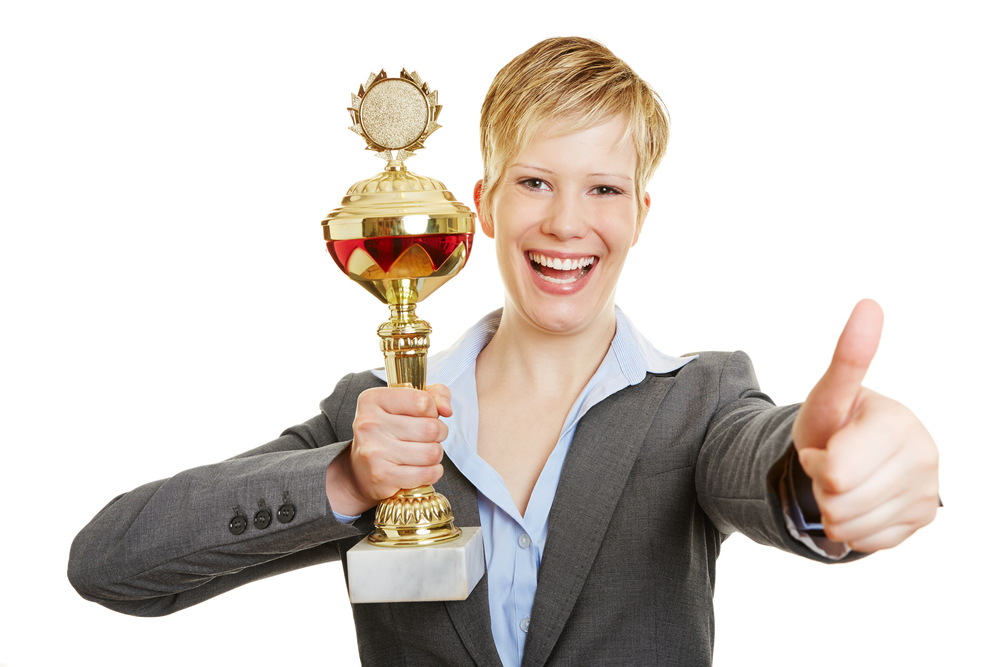Business_woman_with_trophy_and_thumbs_up