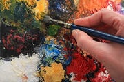 Paintbrushes_and_hand